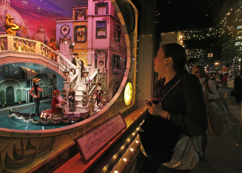 FILE - In this Nov. 14, 2007 file photo, a woman pauses to view the elaborate holiday window display at Lord & Taylor's flagship store on Fifth Avenue
