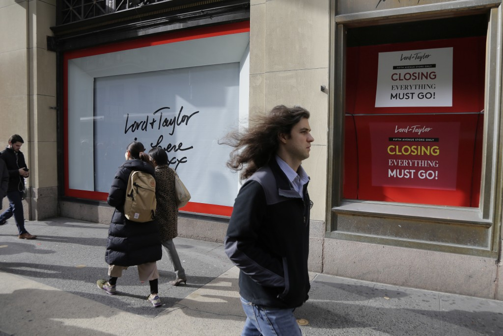 In this Nov. 20, 2018 photo, pedestrians pass by the front of Lord & Taylor's flagship store in New York.  Lord & Taylor was the city's first departme...