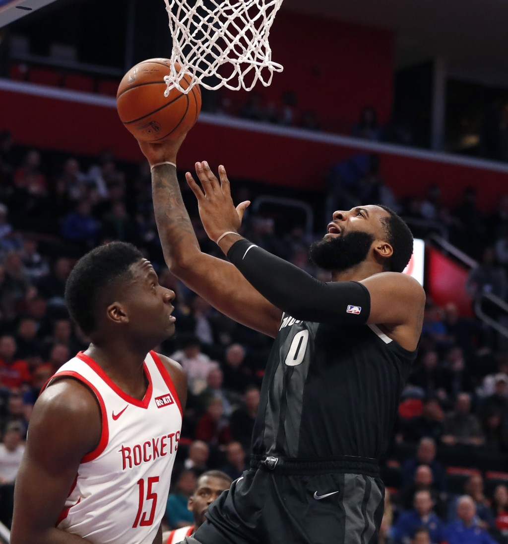 Detroit Pistons center Andre Drummond (0) makes a layup as Houston Rockets center Clint Capela (15) defends during the first half of an NBA basketball