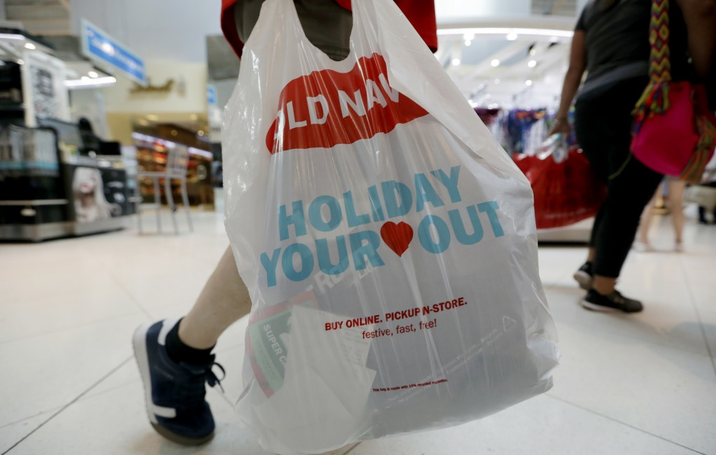 A Black Friday shopper walks through Dolphin Mall on Friday, Nov. 23, 2018, in Miami. Retailers are offering much of their Black Friday deals online,