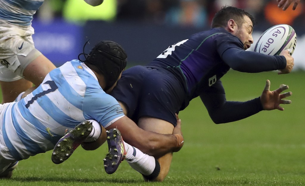 Scotland's Greig Laidlaw, right, is tailed by Argentina's Pablo Matera during the rugby union international match between Scotland and Argentina at Mu...