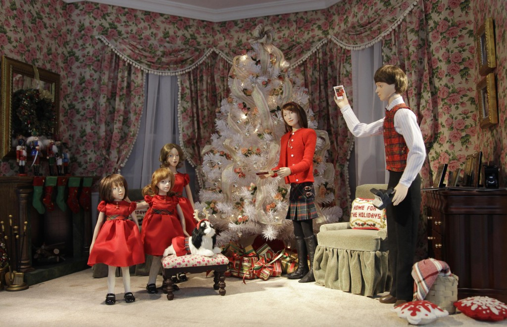 FILE - In this Nov. 17, 2010 file photo, a store window Christmas scene is part of the holiday display at the Lord & Taylor flagship store in New York...