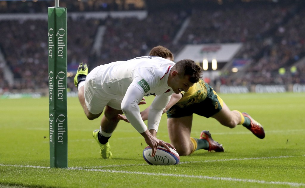 England's Jonny May scores his team's opening try during the rugby union international between England and Australia at Twickenham in London, Saturday