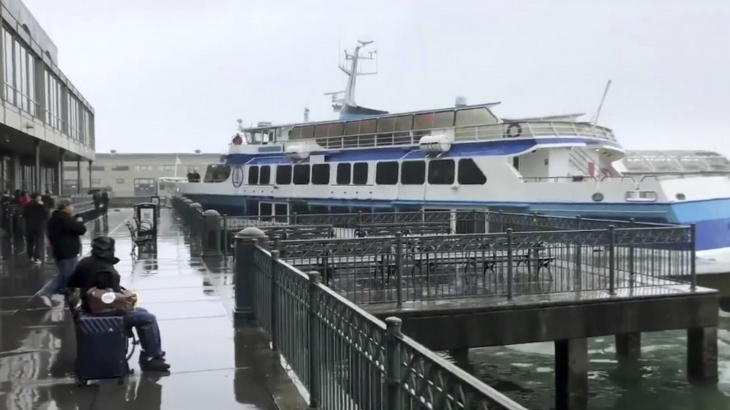 In this image taken from video a ferry carrying dozens of passengers crashes into a dock at San Francisco's famed Ferry Building on Friday, Nov. 23, 2