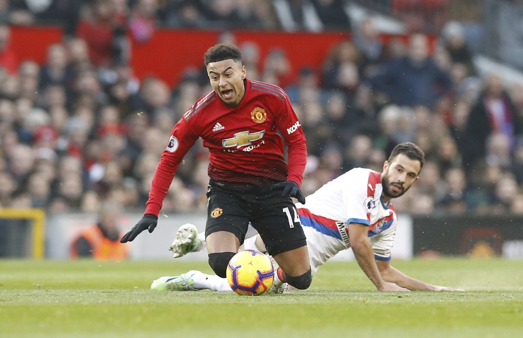 Manchester United's Jesse Lingard, left, is fouled by Crystal Palace's Luka Milivojevic during their English Premier League soccer match at Old Traffo...