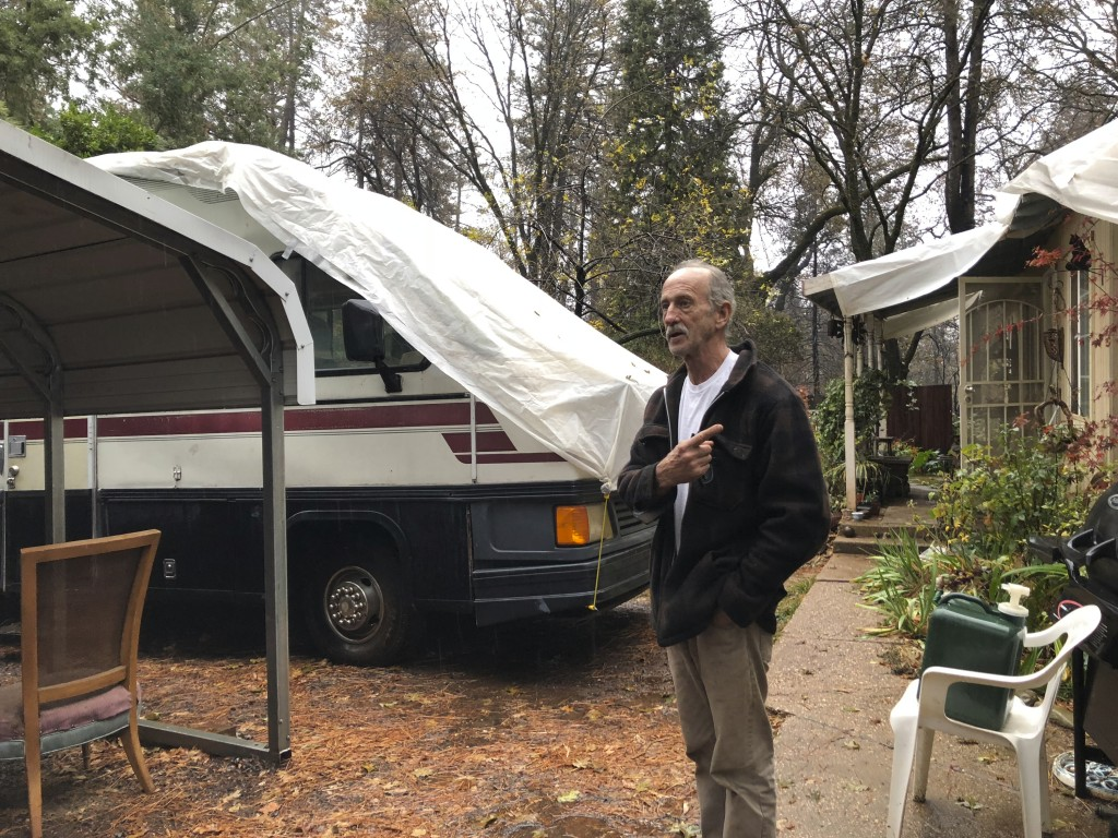 Resident Stewart Nugent who stayed in his home and fought off the flames of a deadly wildfire stands outside his surviving home in Paradise, Calif., o...