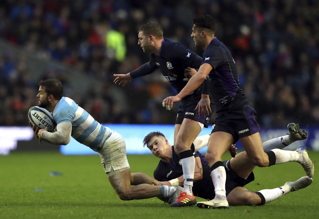 Argentina's Sebastian Cancelliere, left, is tackled by Scotland's Huw Jones, bottom, during the rugby union international match between Scotland and A...