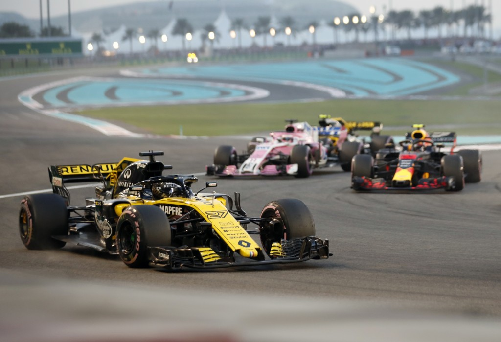 Renault driver Nico Hulkenberg of Germany, front, steers his car after the start of the Emirates Formula One Grand Prix at the Yas Marina racetrack in...