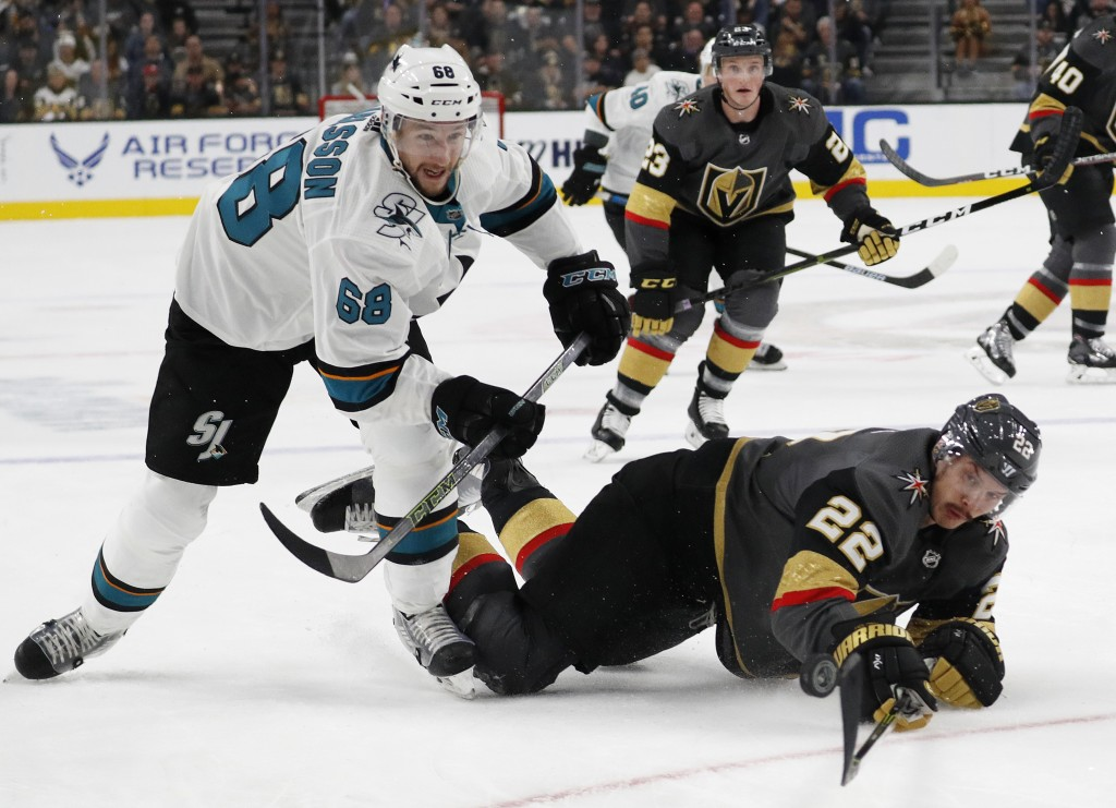 San Jose Sharks center Melker Karlsson (68) and Vegas Golden Knights defenseman Nick Holden (22) vie for the puck during the first period of an NHL ho...