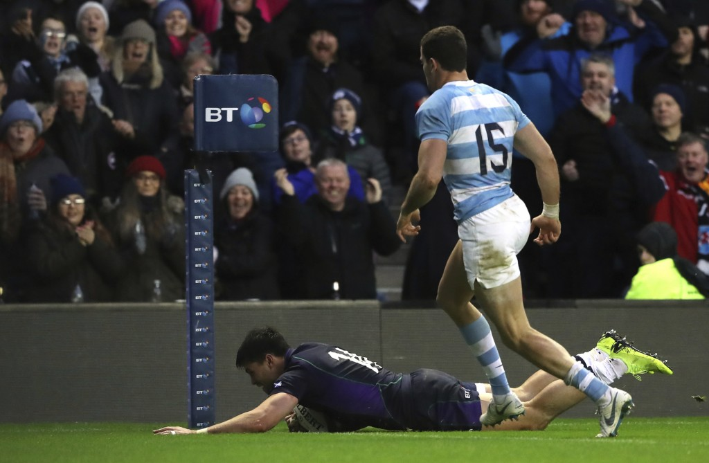Scotland's Sean Maitland, bottom, scores a try as Argentina's Emiliano Boffelli watches on during the rugby union international match between Scotland