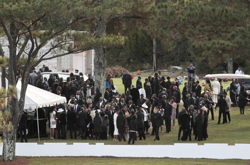 Mourners attend funeral services and interment for former model and actress Kim Porter at Evergreen Memorial Gardens Saturday, Nov. 24, 2018, in Colum...