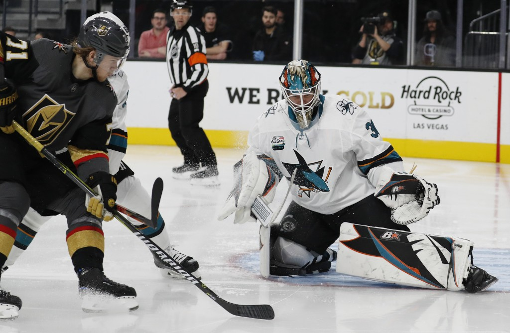 San Jose Sharks goaltender Aaron Dell (30) makes a save against the Vegas Golden Knights during the second period of an NHL hockey game Saturday, Nov....