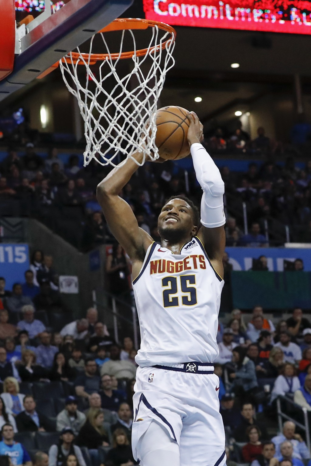 Denver Nuggets guard Malik Beasley (25) goes up for a dunk abasing the Oklahoma City Thunder during the first half of an NBA basketball game in Oklaho...