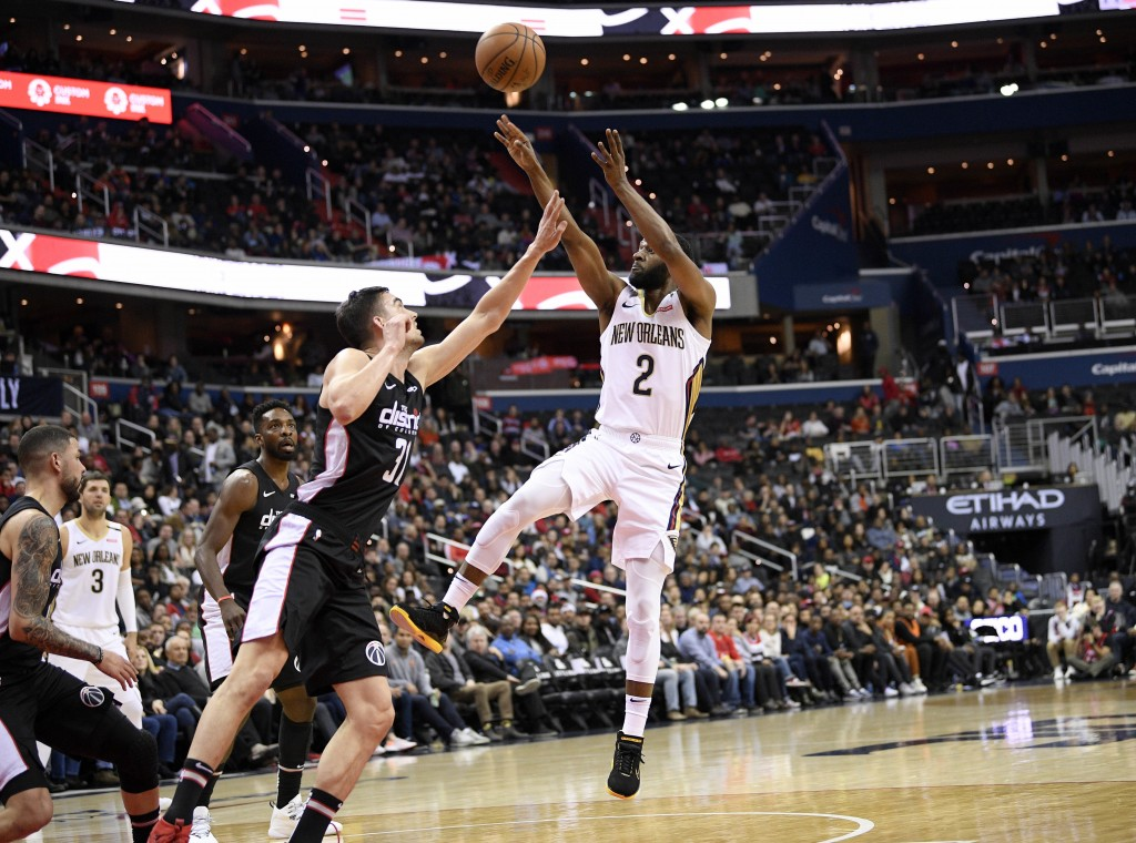 New Orleans Pelicans guard Ian Clark (2) shoots over Washington Wizards guard Tomas Satoransky (31) during the first half of an NBA basketball game Sa...