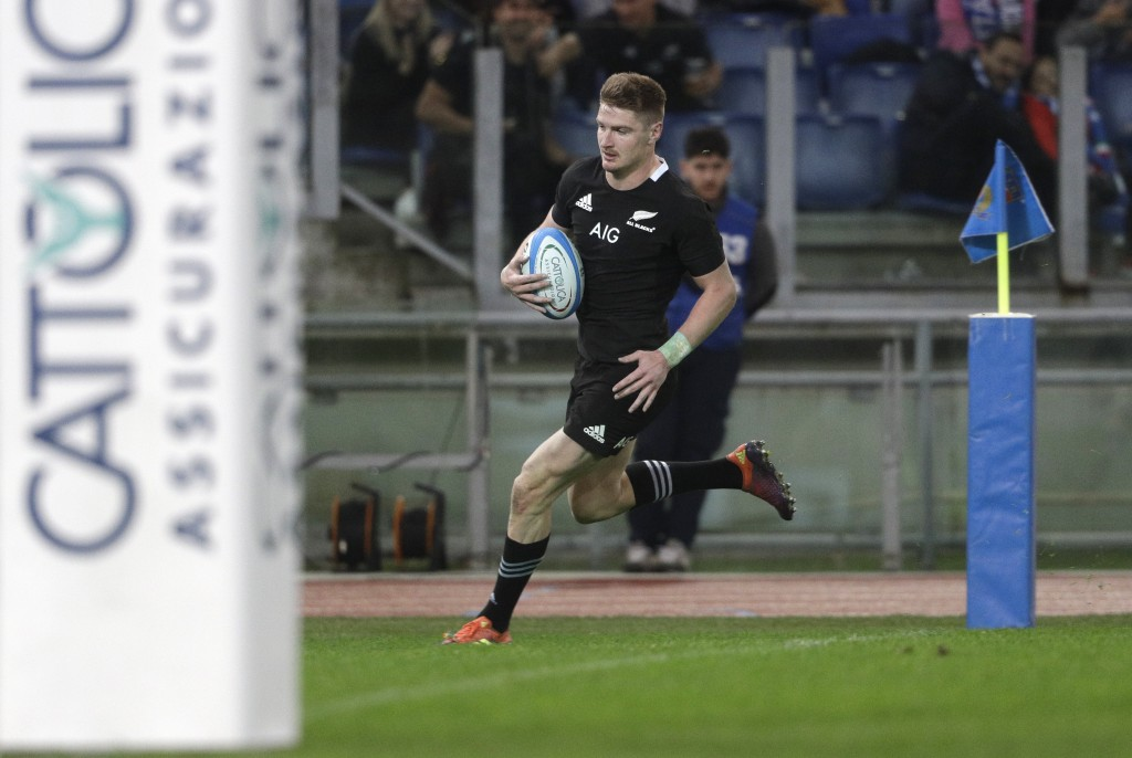 New Zealand's Jordie Barrett runs on his way to score a try during the rugby union international match between Italy and New Zealand at the Olympic St