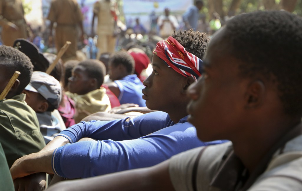 FILE - In this Wednesday, Feb. 7, 2018 file photo, former child soldiers attend a release ceremony where they laid down their weapons and traded in th...
