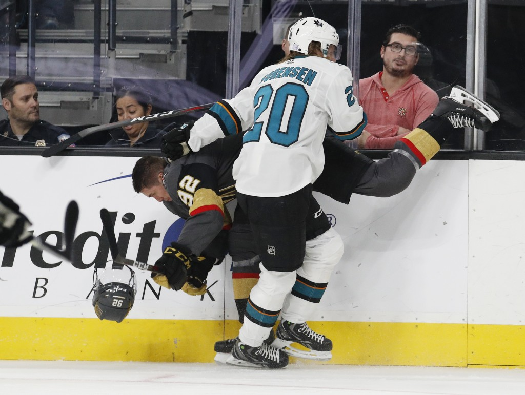 San Jose Sharks left wing Marcus Sorensen (20) checks Vegas Golden Knights left wing Tomas Nosek (92), who loses his helmet during the second period o...