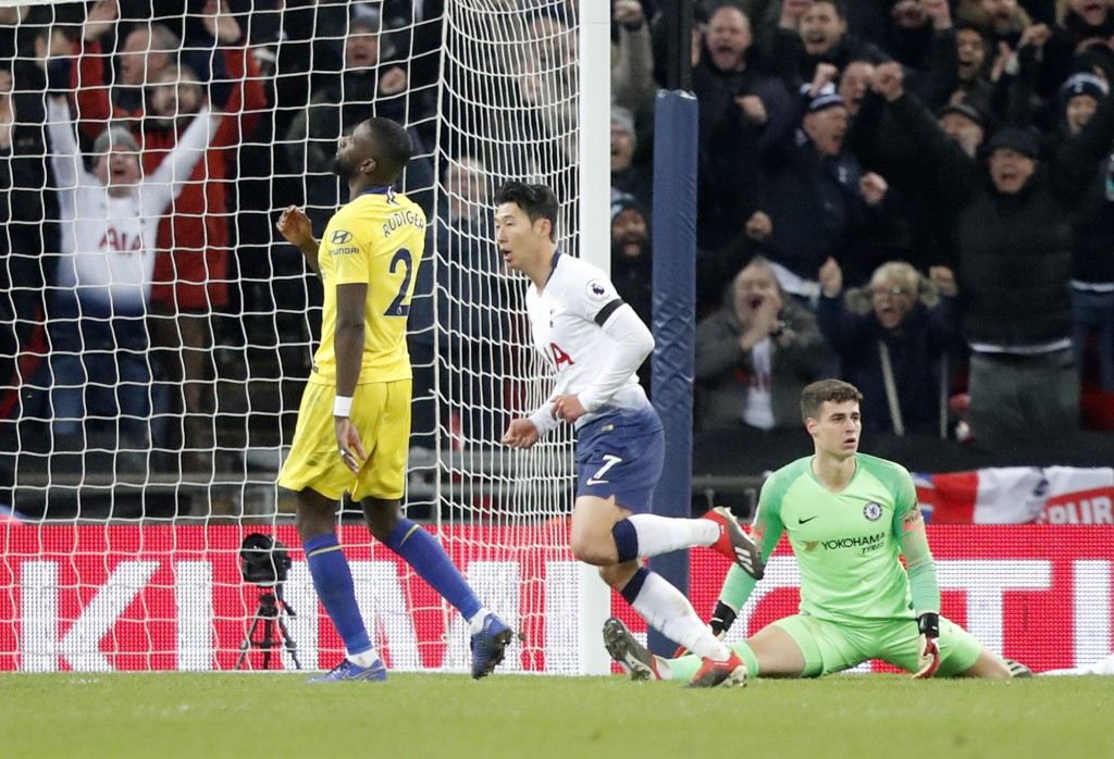 Tottenham's Son Heung-min, center, celebrates after scoring his side's third goal during the English Premier League soccer match between Tottenham Hot