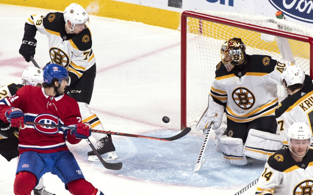 Montreal Canadiens' Phillip Danault tries to deflect the puck past Boston Bruins goaltender Tuukka Rask during the second period of an NHL hockey game...