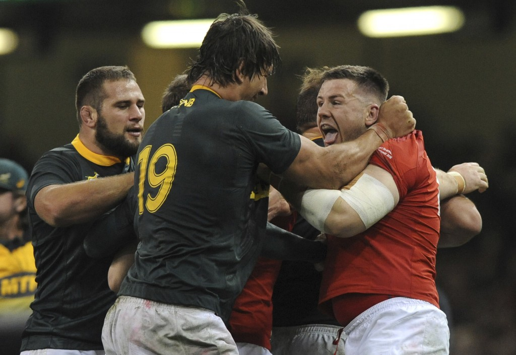 Wales Rob Evans, right, and South Africa's Eben Etzebeth tussle during the rugby union international match between Wales and South Africa at the Princ...