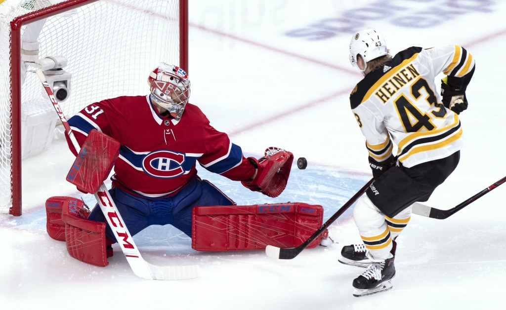 Montreal Canadiens goaltender Carey Price makes a save off Boston Bruins' Danton Heinen during the second period of an NHL hockey game Saturday, Nov.