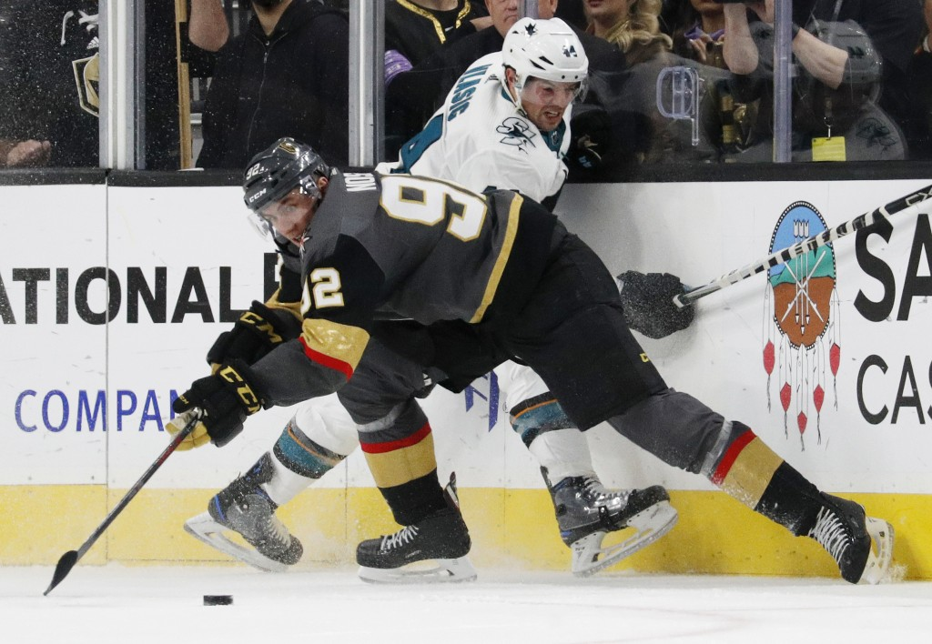 Vegas Golden Knights left wing Tomas Nosek (92) vies for the puck with San Jose Sharks defenseman Marc-Edouard Vlasic (44) during the third period of ...