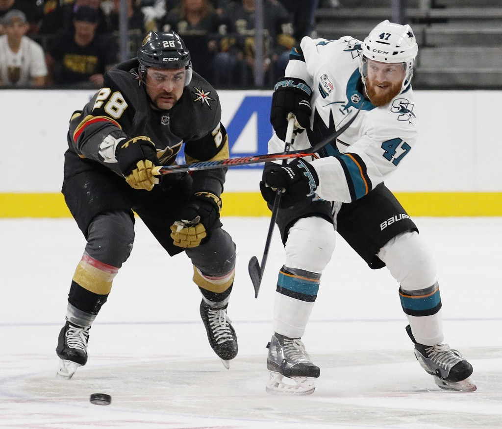San Jose Sharks defenseman Joakim Ryan (47) passes the puck past Vegas Golden Knights left wing William Carrier (28) during the first period of an NHL...