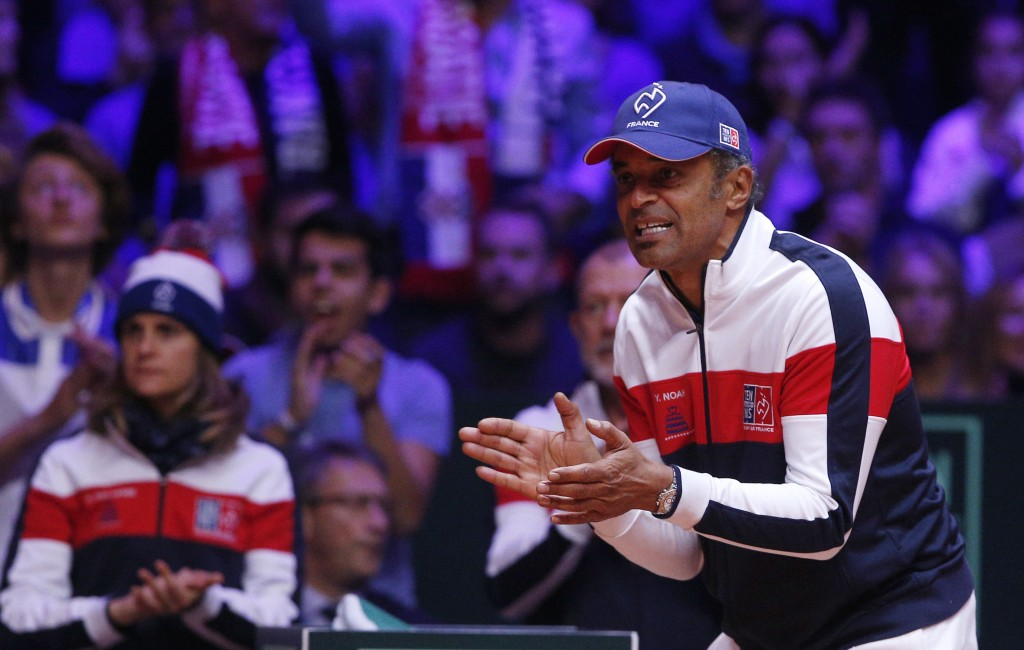 French team captain Yannick Noah applauds as Croatia's Marin Cilic plays France's Lucas Pouille during the Davis Cup final between France and Croatia