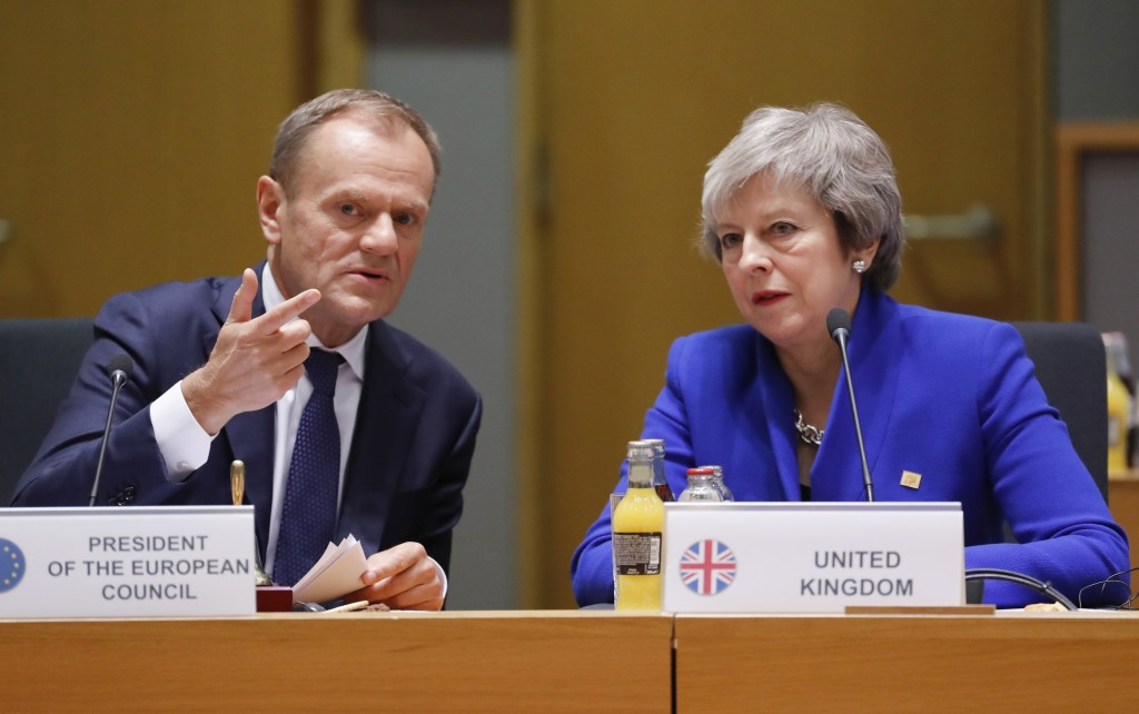 British Prime Minister Theresa May, right, and European Council President Donald Tusk attend a round table meeting at an EU summit in Brussels, Sunday