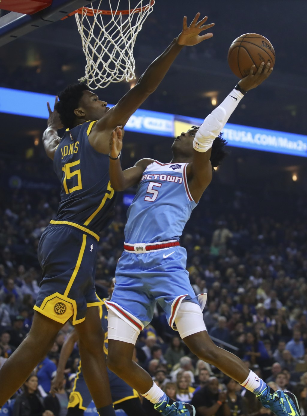Sacramento Kings' De'Aaron Fox, right, shoots against Golden State Warriors' Damian Jones during the first half of an NBA basketball game Saturday, No