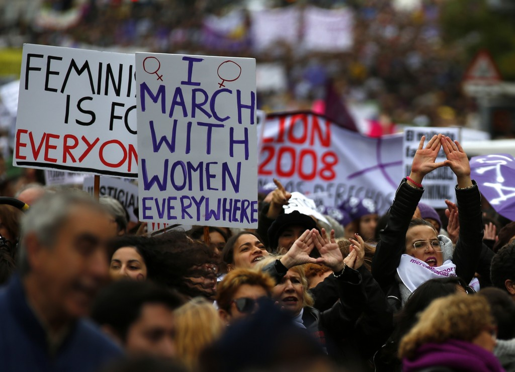 People take part during a protest against sexism and gender violence in Madrid, Spain, Sunday, Nov. 25, 2018. Many thousands are expected to join rall...