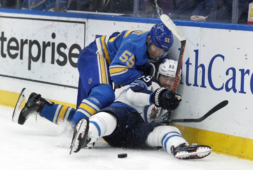 Winnipeg Jets' Mark Scheifele, right, is checked by St. Louis Blues' Colton Parayko during the first period of an NHL hockey game Saturday, Nov. 24, 2...