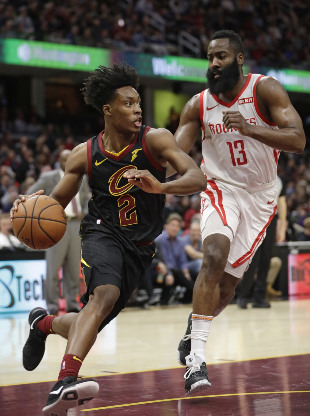 Cleveland Cavaliers' Collin Sexton (2) drives past Houston Rockets' James Harden (13) in the first half of an NBA basketball game, Saturday, Nov. 24, ...