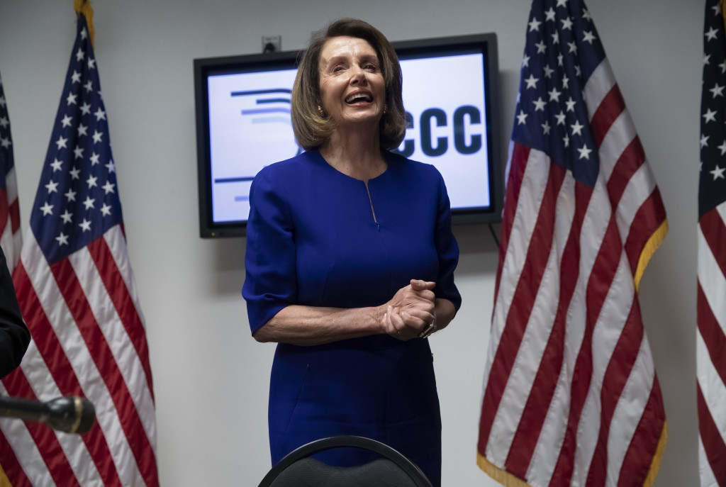 FILE - In this Nov. 6, 2018, file photo, House Democratic Leader Nancy Pelosi of California, smiles as she meets with reporters on Election Day at the...