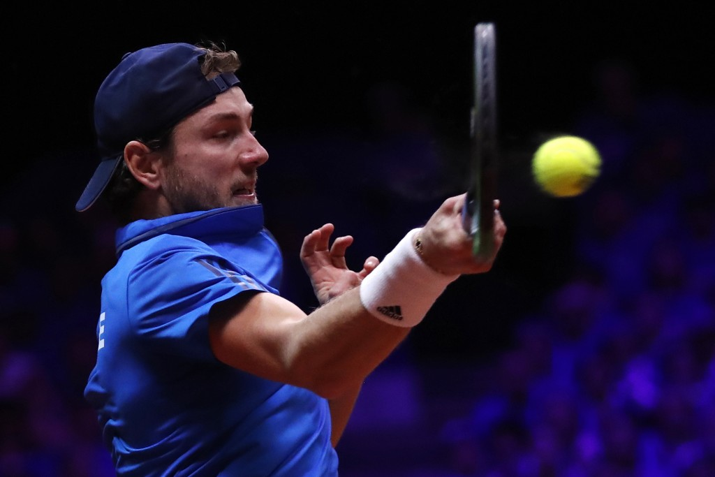 France's Lucas Pouille returns the ball to Croatia's Marin Cilic during the Davis Cup final between France and Croatia Sunday, Nov. 25, 2018 in Lille,...