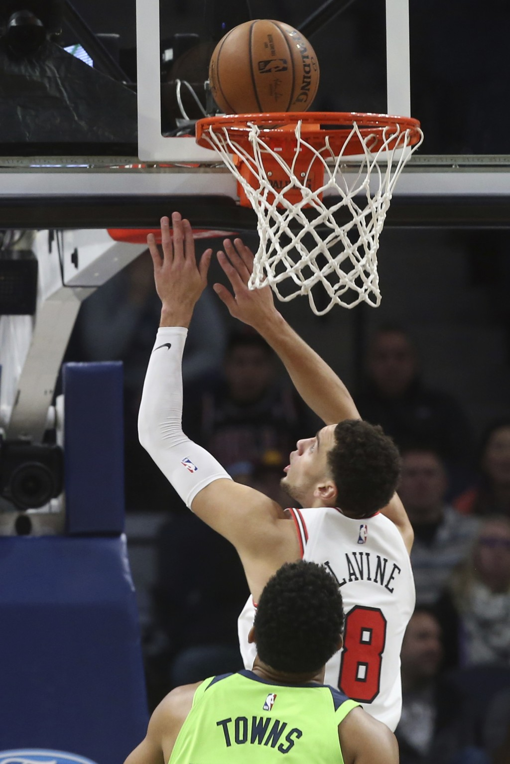 Chicago Bulls' Zach LaVine makes a layup as Minnesota Timberwolves' Karl-Anthony Towns watches in the first half of an NBA basketball game Saturday, N