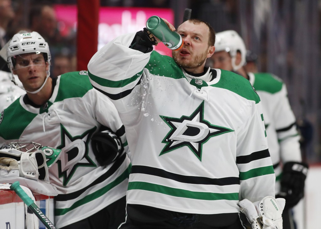 Dallas Stars goaltender Anton Khudobin drinks during a timeout in the first period of an NHL hockey game against Colorado Avalanche, Saturday, Nov. 24