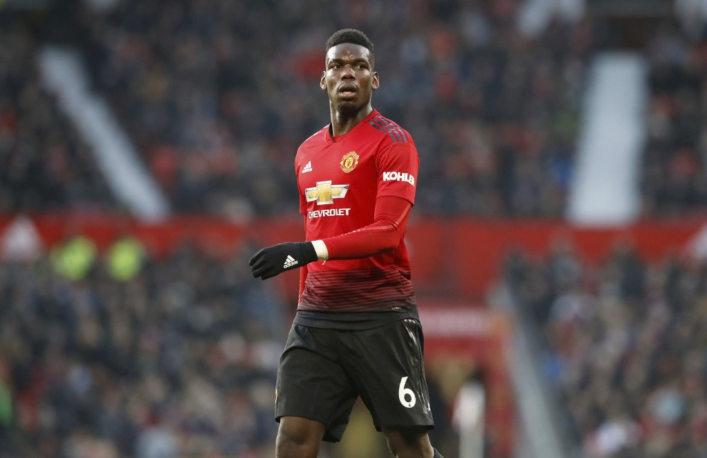Manchester United's Paul Pogba in action during their English Premier League soccer match against Crystal Palace at Old Trafford, Manchester, England,