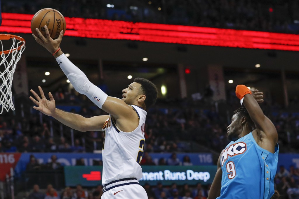 Denver Nuggets guard Jamal Murray (27) goes to the basket ahead of Oklahoma City Thunder forward Jerami Grant (9) during the first half of an NBA bask...