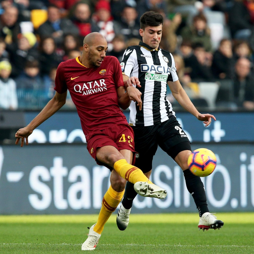 Udinese's Ignacio Pussetto, right, and Roma's Steven Nzonzi vie for the ball during the Serie A soccer match between Udinese and Roma at the Friuli st...