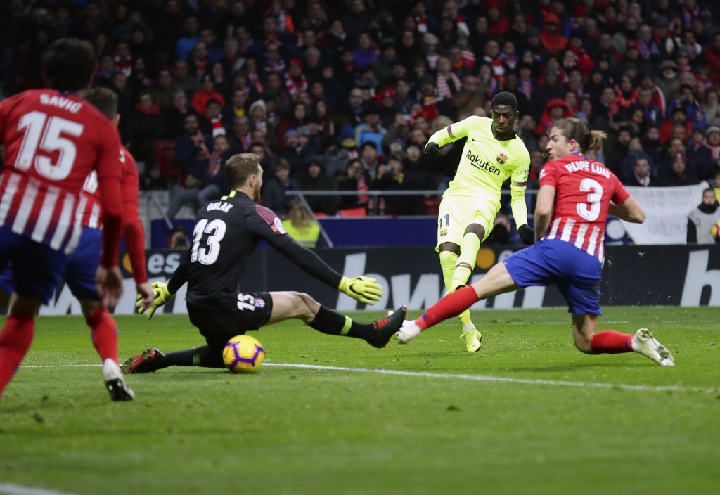 Barcelona's Ousmane Dembele, second right, scores his side's opening goal during a Spanish La Liga soccer match between Atletico Madrid and FC Barcelo