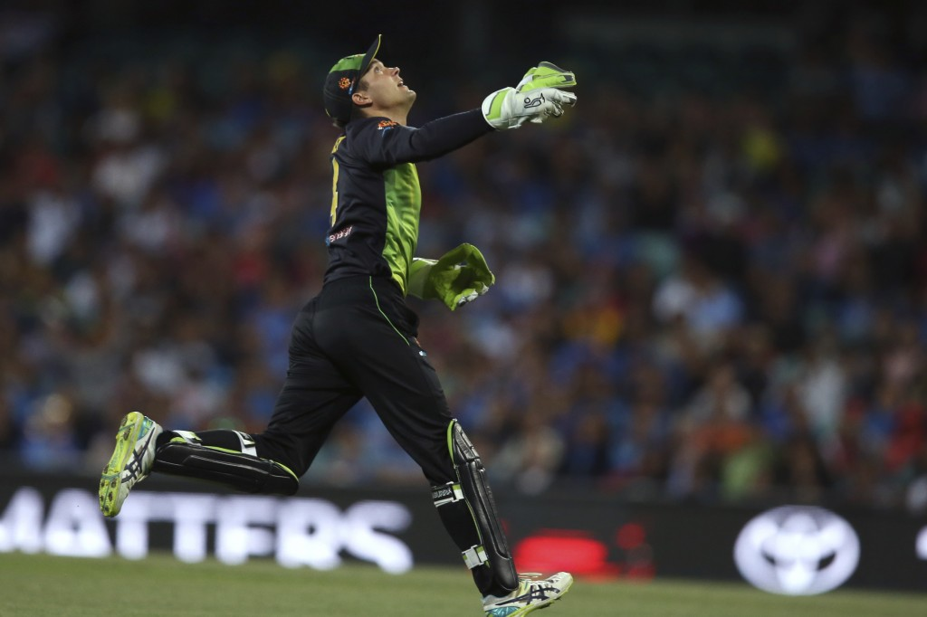 Australia's Alex Carey reacts after taking a catch to dismiss India's Rishabh Pant during their Twenty20 cricket match in Sydney, Sunday, Nov. 25, 201