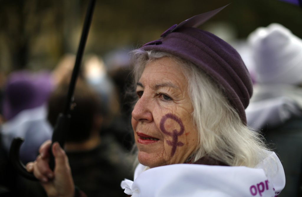 A woman takes part during a protest against sexism and gender violence in Madrid, Spain, Sunday, Nov. 25, 2018. More than 40 marches are being held ac