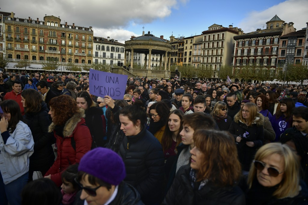 A participant holds banner reading,''Not one less'' as people gather at Plaza del Castillo square to protest male violence against women, in Pamplona,...
