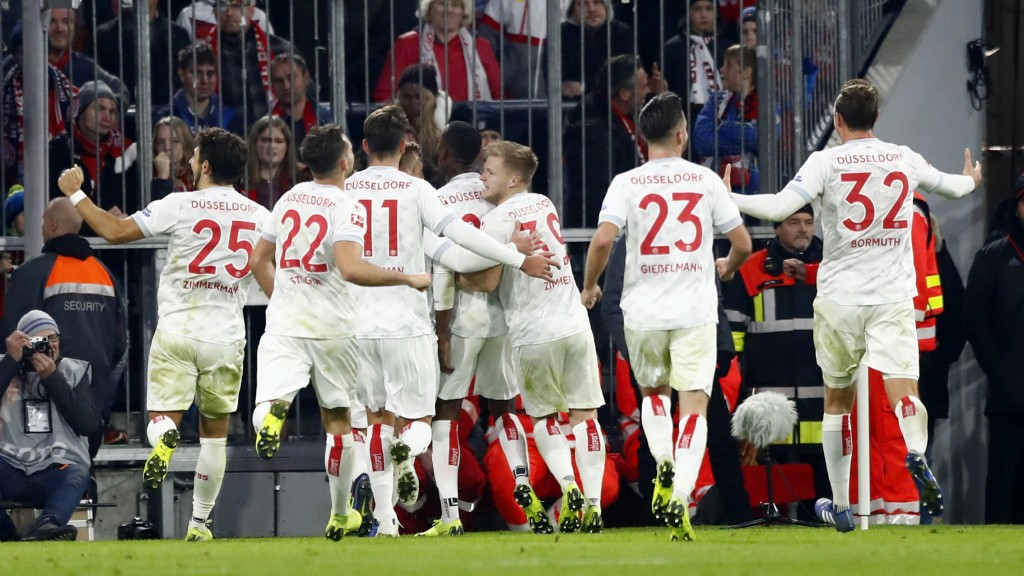 Duesseldorf's scorer Dodi Lukebakio and his teammates celebrate their side's third goal during the German Bundesliga soccer match between FC Bayern Mu
