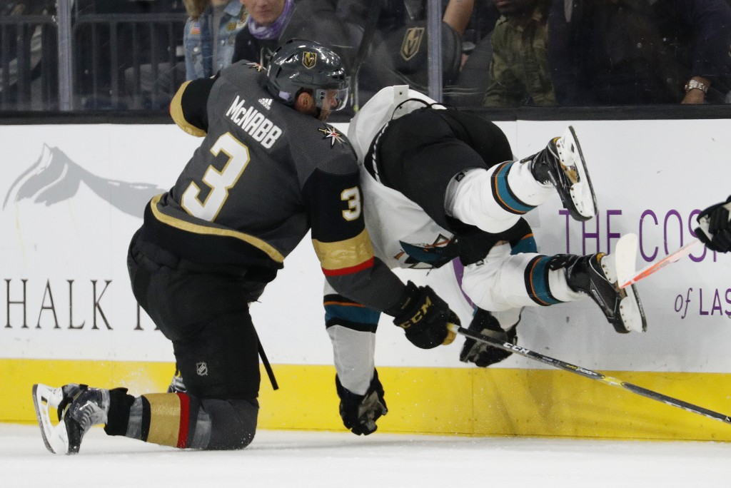 Vegas Golden Knights defenseman Brayden McNabb (3) checks San Jose Sharks right wing Joonas Donskoi (27) during the second period of an NHL hockey gam...