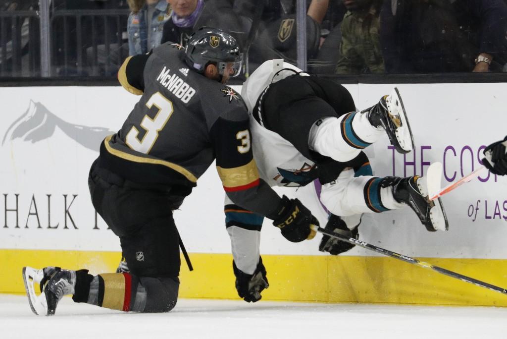 Vegas Golden Knights defenseman Brayden McNabb (3) checks San Jose Sharks right wing Joonas Donskoi (27) during the second period of an NHL hockey gam