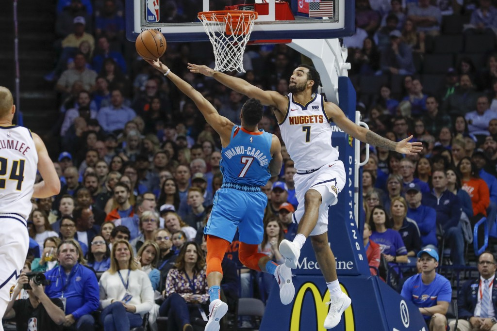 Denver Nuggets forward Trey Lyles, right, defends the basket as Oklahoma City Thunder guard Timothe Luwawu-Cabarrot, left, goes up for a shot during t...