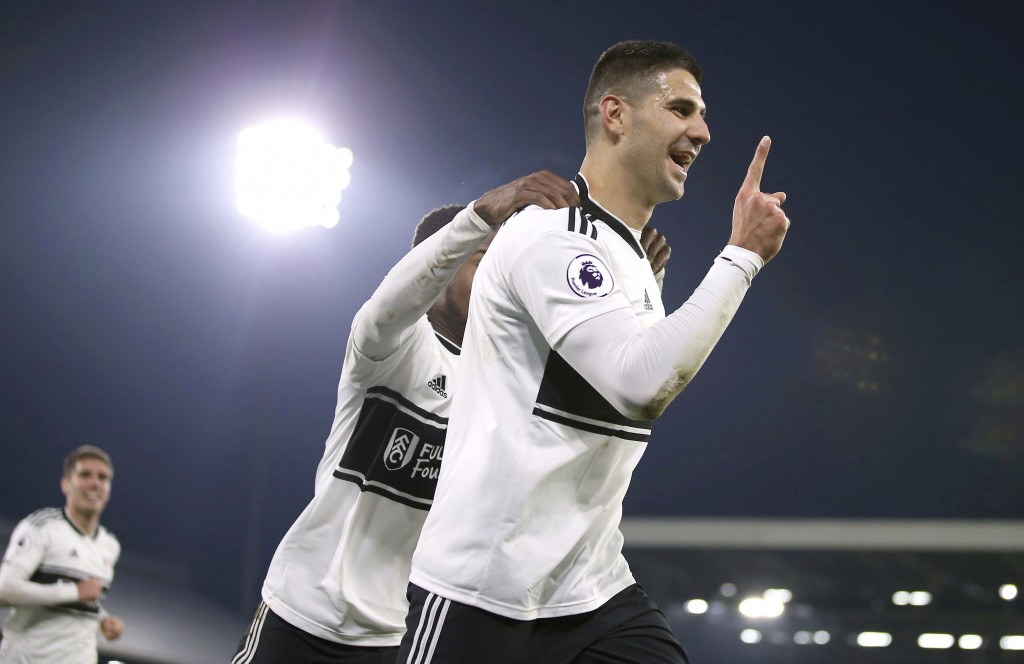 Fulham's Aleksandar Mitrovic celebrates after scoring his side's third goal during a Premier League soccer match between Fulham and Southampton, at Cr...