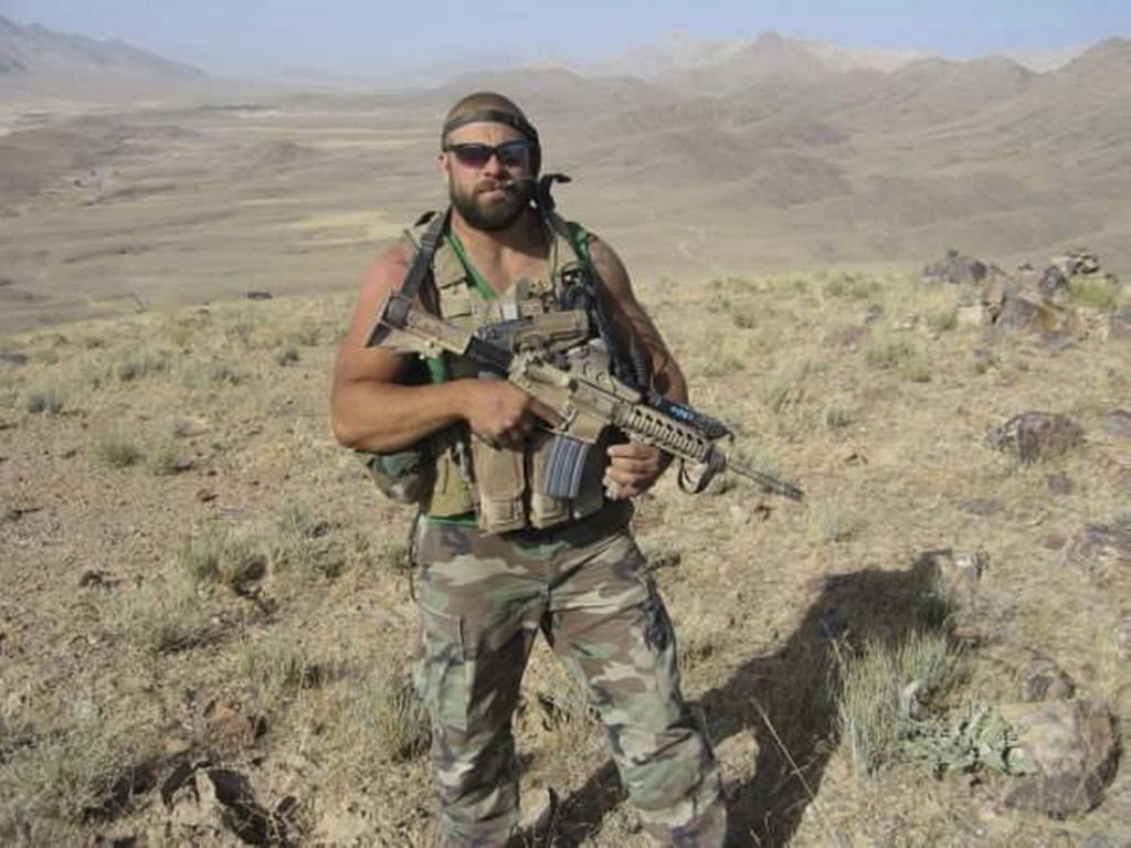 This 2007 photo provided by Christopher Schott shows him in the northern Kandahar Province in Afghanistan. After being in firefights in Afghanistan an...